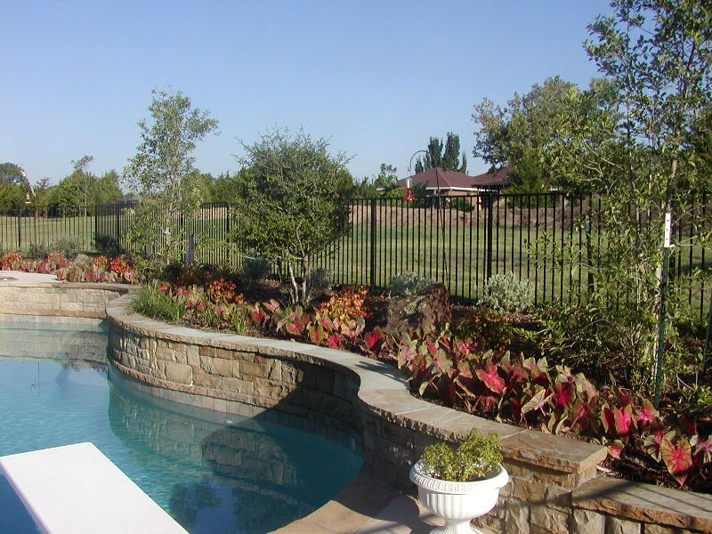 Plano outdoor kitchens designs frisco landscape lighting for Garden designs around pools