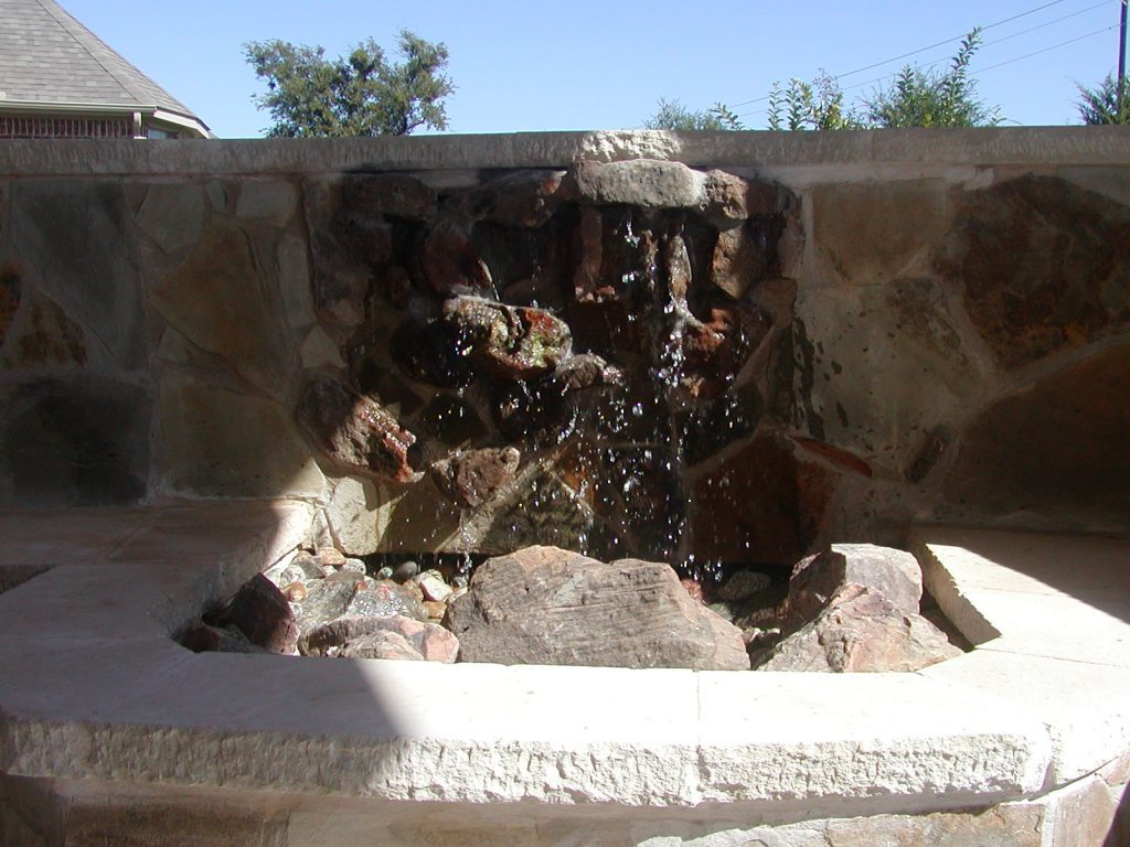 Cool off your backyard with a water fall in your backyard.